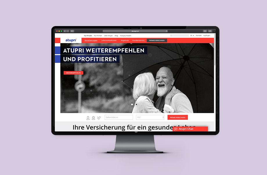 Auf einem Desktop ist die Landingpage von Atupri.ch abgebildet.